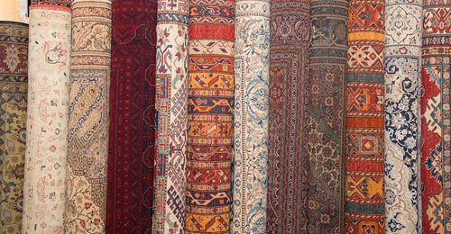 Rolled-up oriental rugs