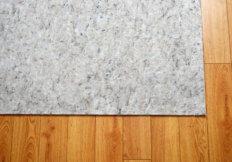 rug pad on hardwood floor